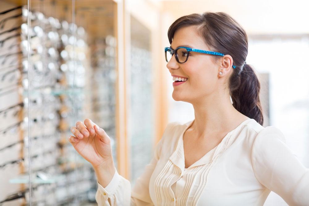woman shopping for blue frame glasses