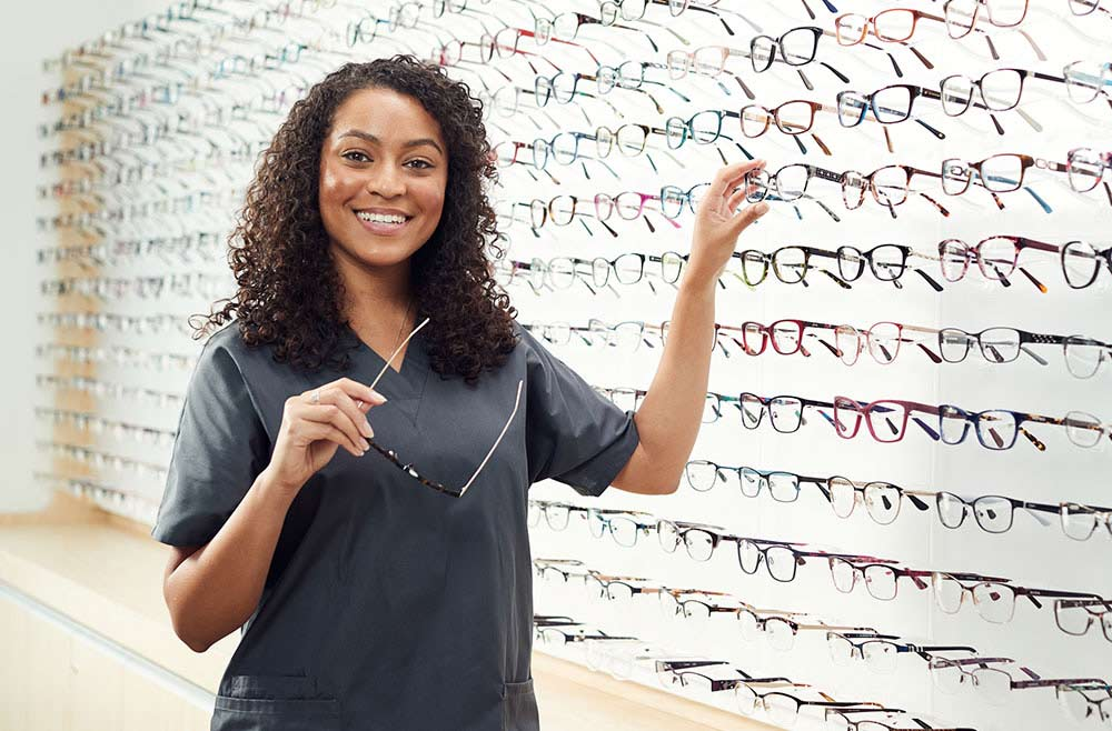 optometrist helping pick out glasses