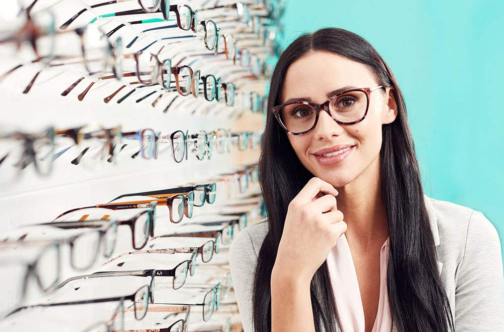 female trying on glasses at shopko optical