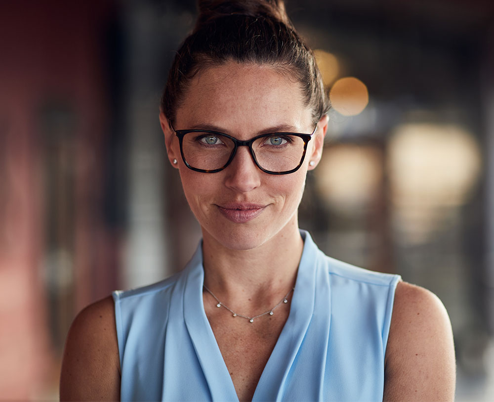 woman in blue shirt with black glasses on