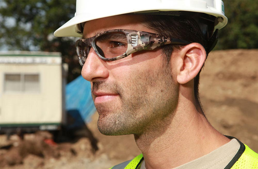 safety work glasses on employee