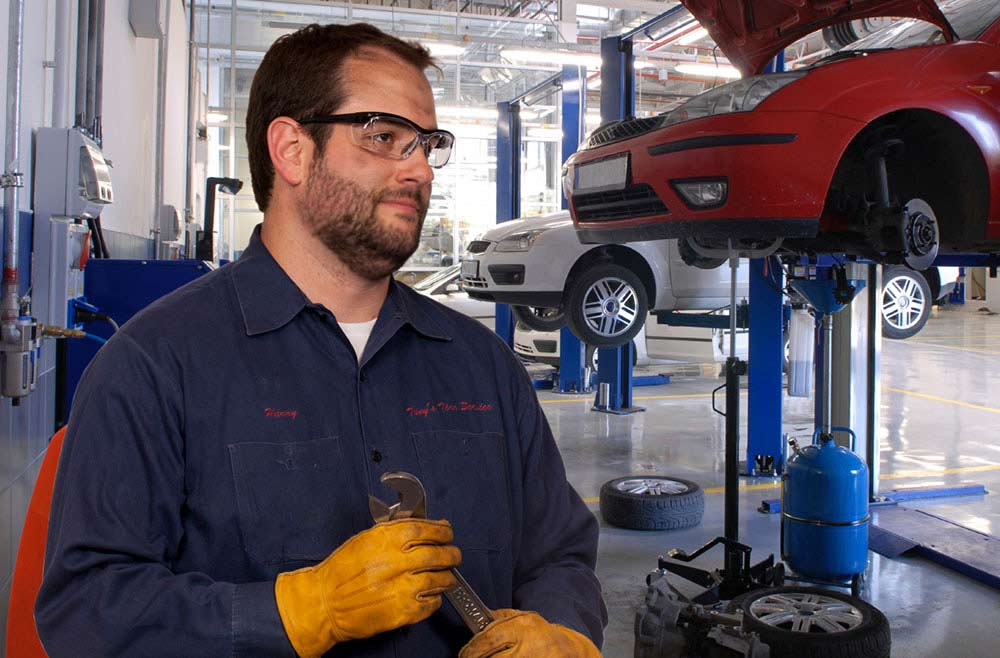 mechanic wearing safety eyeglasses in auto shop