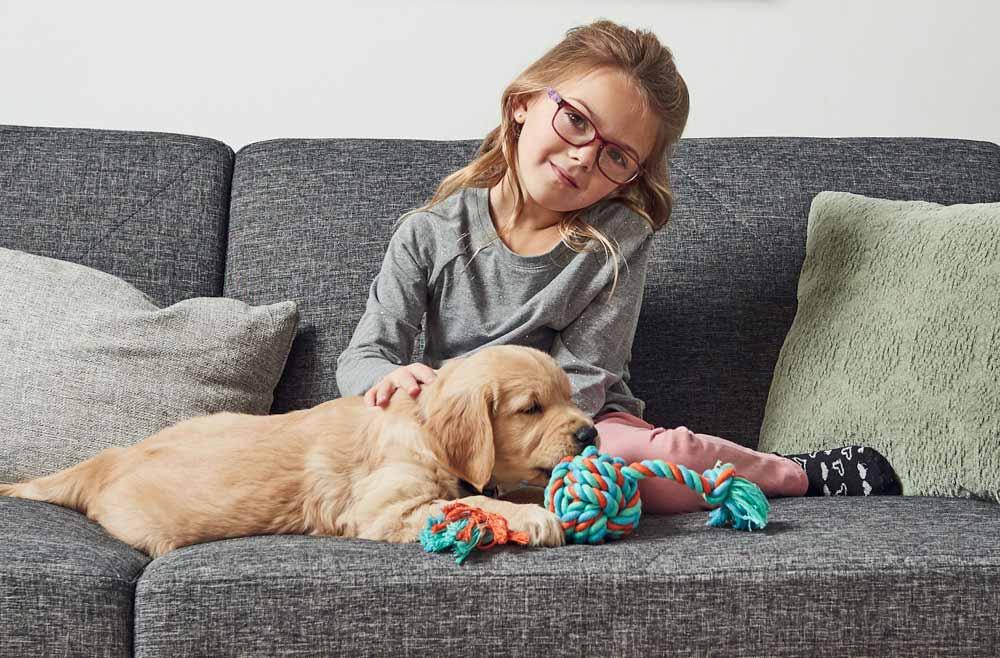 little girl wearing glasses