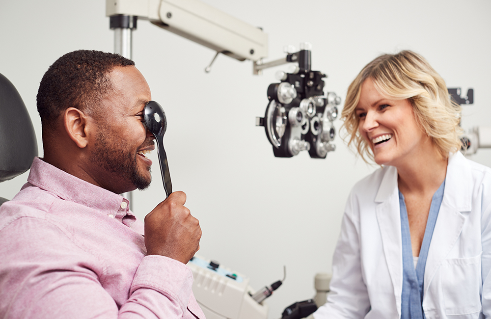 Optometrist assisting patient
