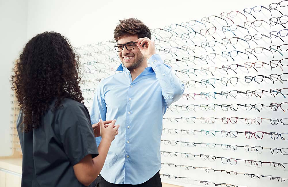 man trying on glasses at Shopko Optical