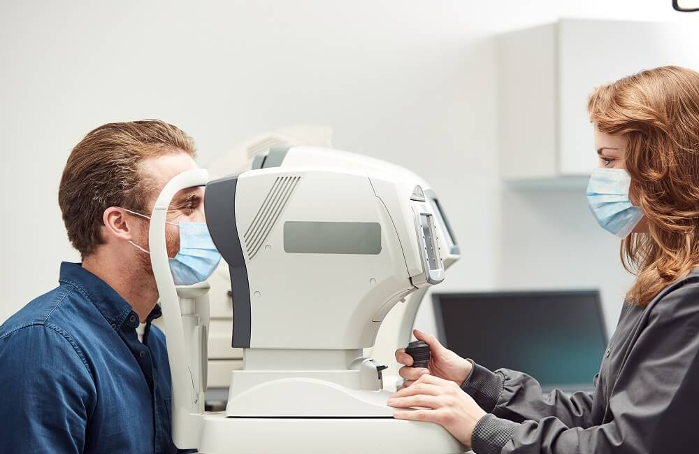Optician and Patient with Mask