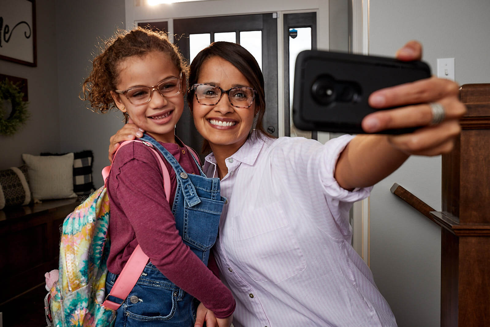 mother and daughter taking back-to-school selfie