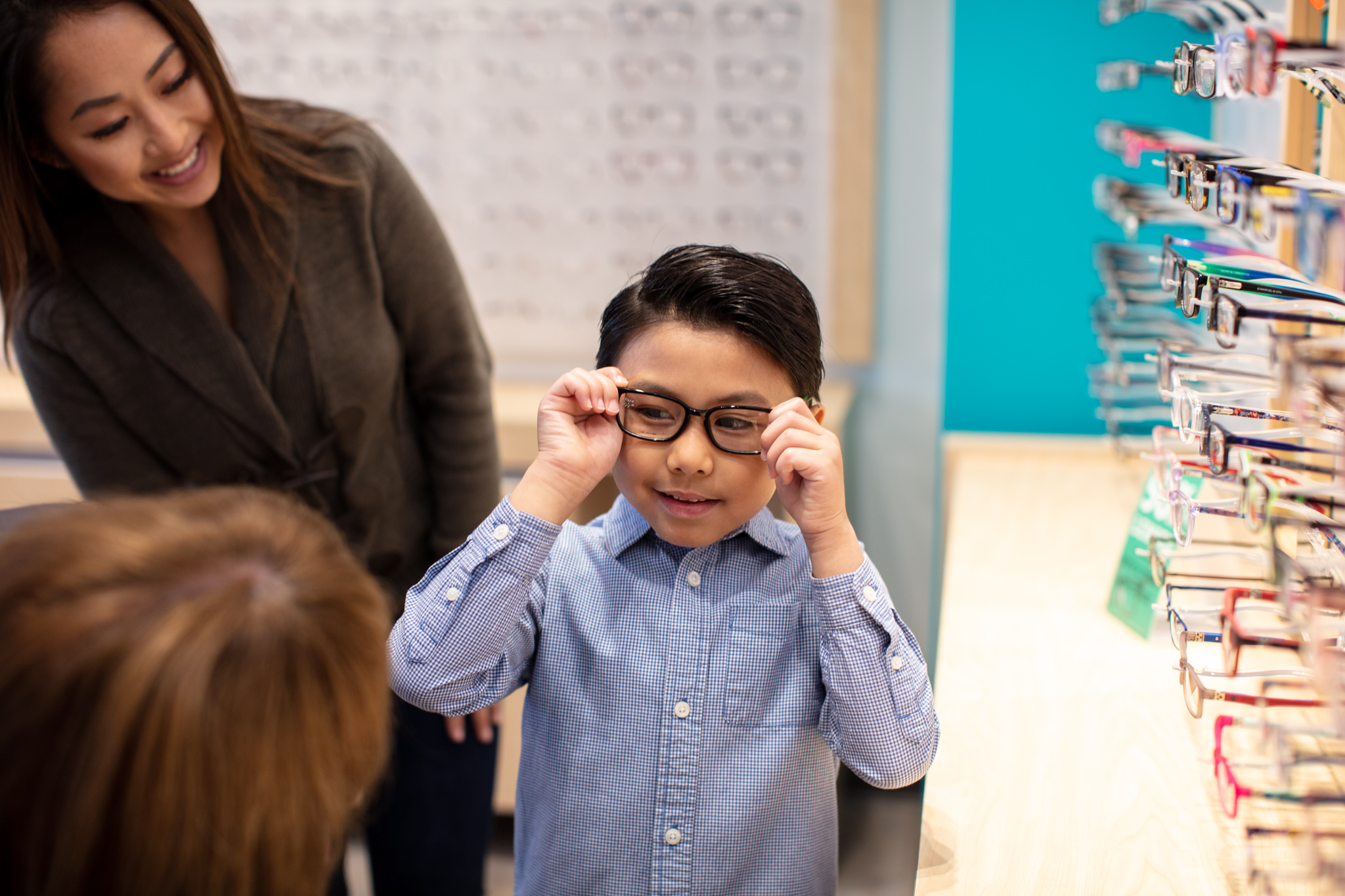 young boy trying on glasses at Shopko Optical