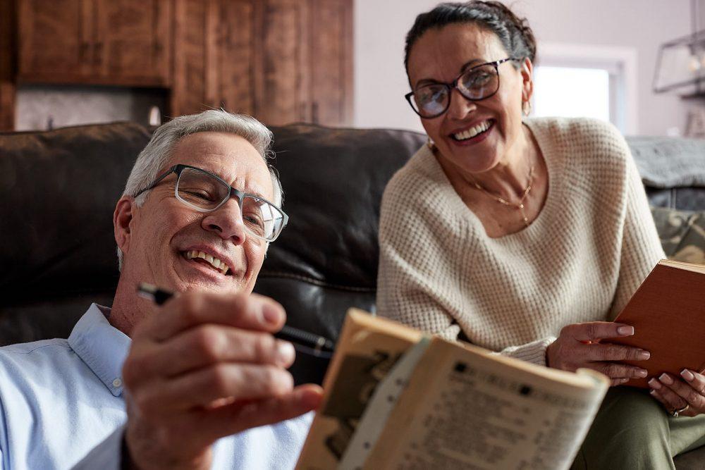 man and woman looking at book